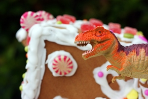gingerbread house with dinosaur