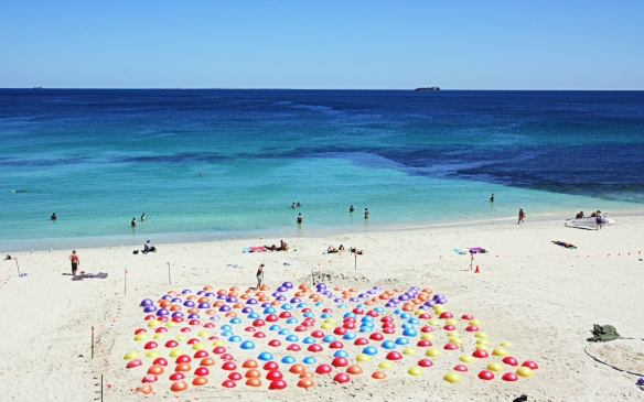 The finished work - a dot painting on the beach, against the backdrop of the Indian Ocean