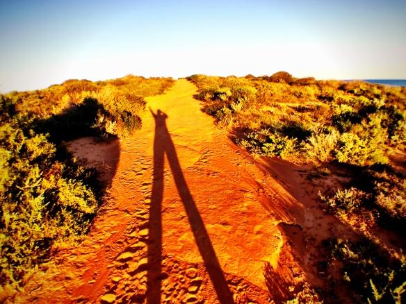 long shadows in red dirt, by @debsnet