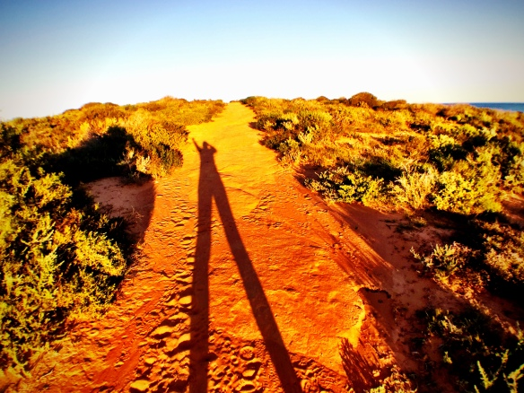 long shadows in red dirt, by @debsnet